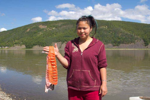 Young Native Yupic With Salmon